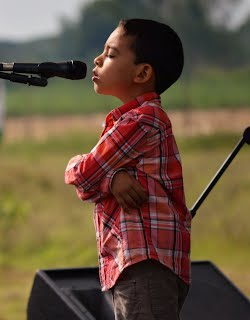 A young boy prays during the temple groundbreaking in Agua Azul on 22 May.